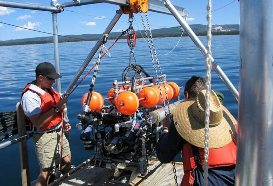 A remotely operated vehicle is prepared for deployment into Yellowstone Lake to help study unique life that has proliferated around a lake-bottom geothermal vent.