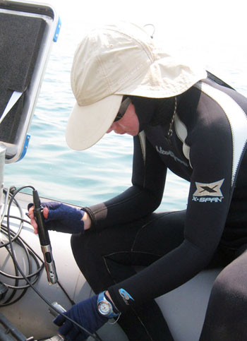 Wright State Ph.D. candidate Brianne Kelly takes oxygen measurements at Lake Tanganyika in east Africa.